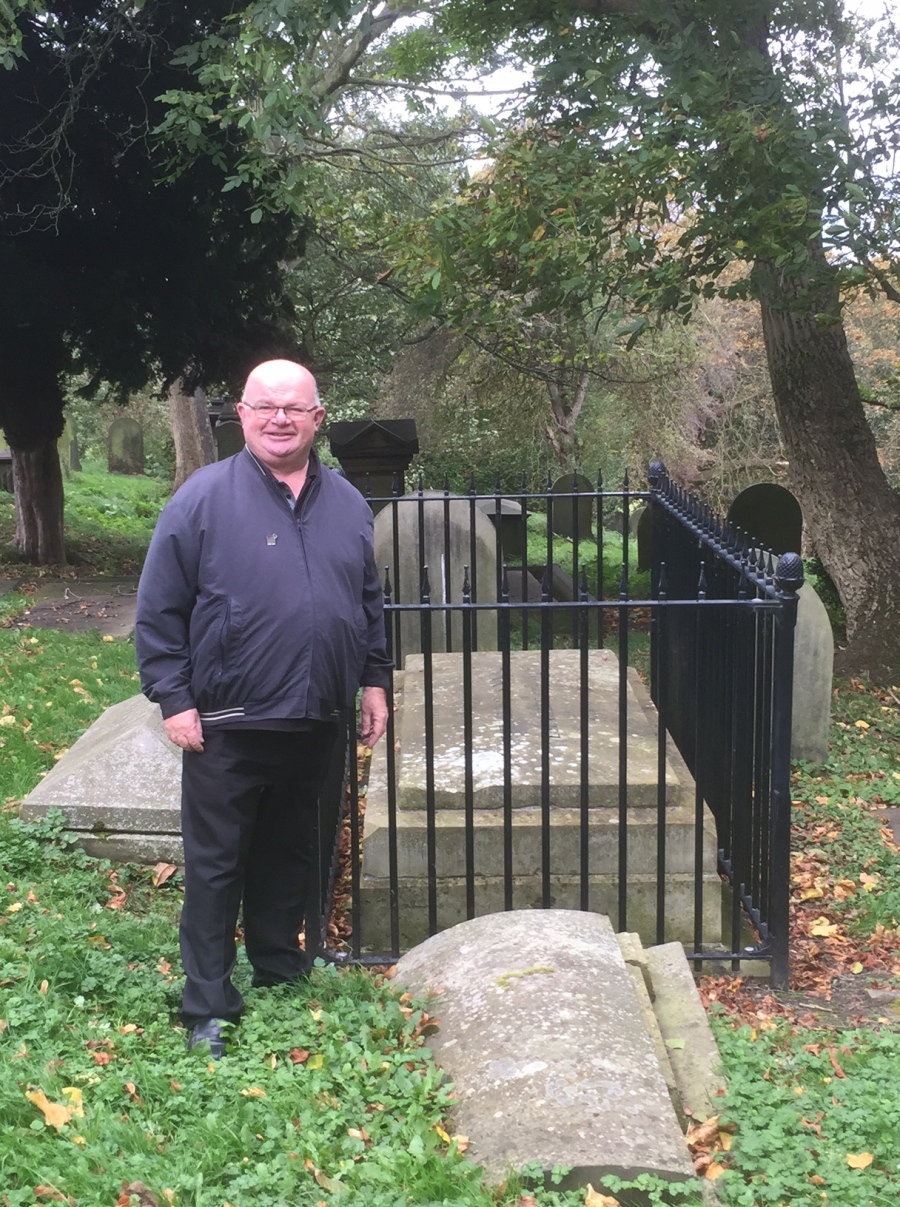 Gerard Dempsey at the grave of Ebenezer Elliott