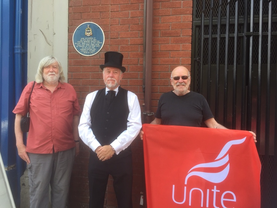 Unite members John Mooney and Anthony Shaw with historian Simon Entwistle at the plaque on Darwen Street111-31314