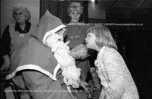 John Taylor, SOGAT London Machine Branch, is Father Christmas at the kids party they held for striking miner's children. South Kirkby. 07/12/1984.