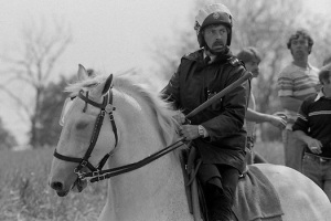 Mounted Policeman with drawn long baton. Orgreave. 30/05/1984.